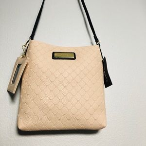Light pink Steve Madden shoulder bag.